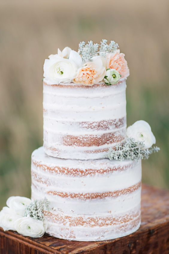 Semi Naked Wedding Cake Topped With Pastel Flowers And Greenery