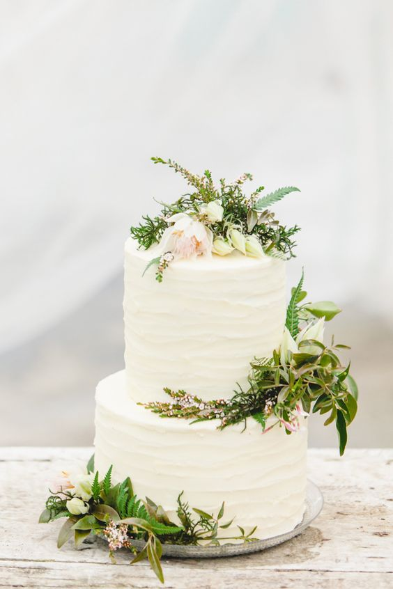 wedding cake topped with fresh greenery