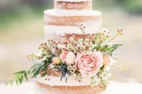 40 semi naked wedding cake with floral decor