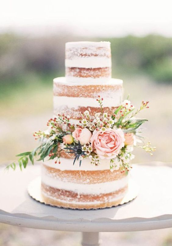 semi naked wedding cake with floral decor
