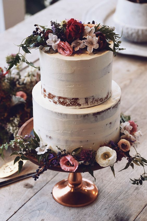 semi naked wedding cake with wildflowers are ideal for a boho fete