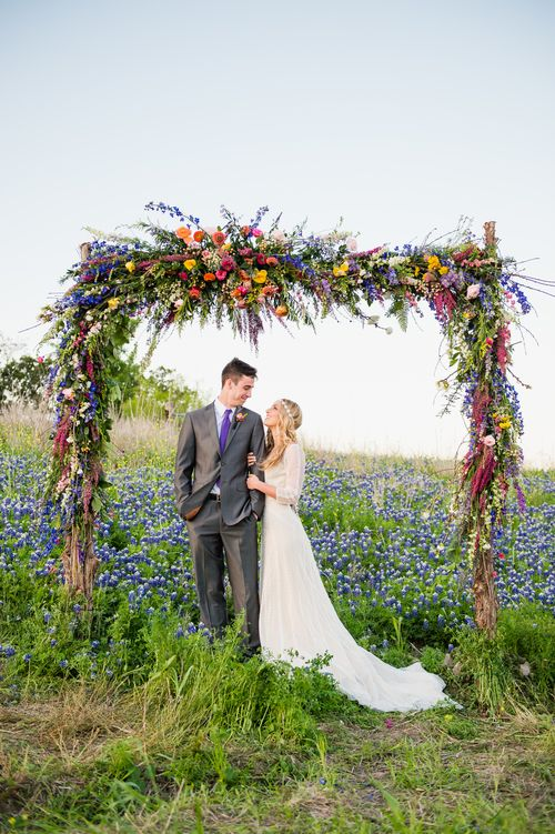 lush spring wildflower wedding arch looks gorgeous