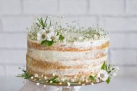46 naked cake topped with wildflowers