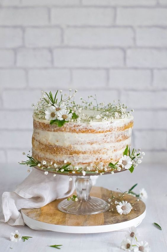 naked cake topped with wildflowers