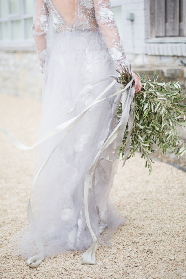 Dove grey lace wedding dress with long sleeves and cutout back