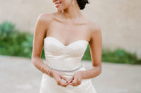 02 The first bridal look was done with a short fitted peplum wedding dress with an embellished belt and modern jewelry