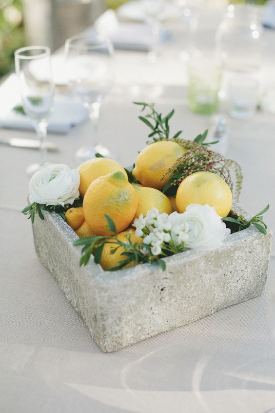 a concrete bowl with fruit and flowers for a bold statement