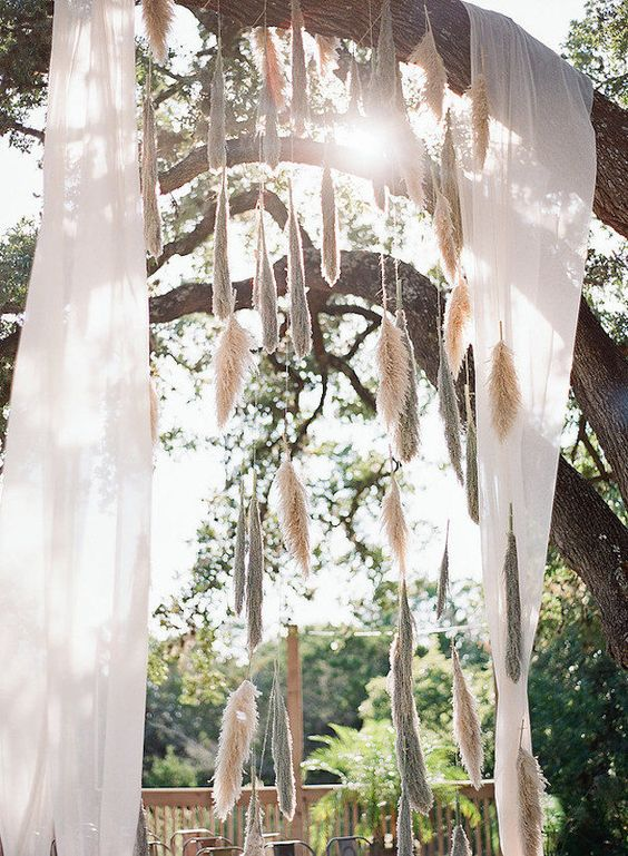 airy fabric and pampas hangings for the wedding altar