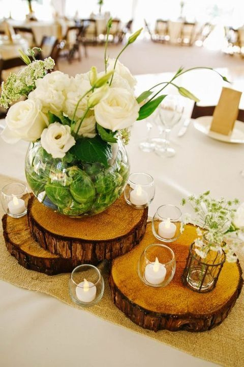 Wood Slices With Candle Holders And A Large Vase White Fls