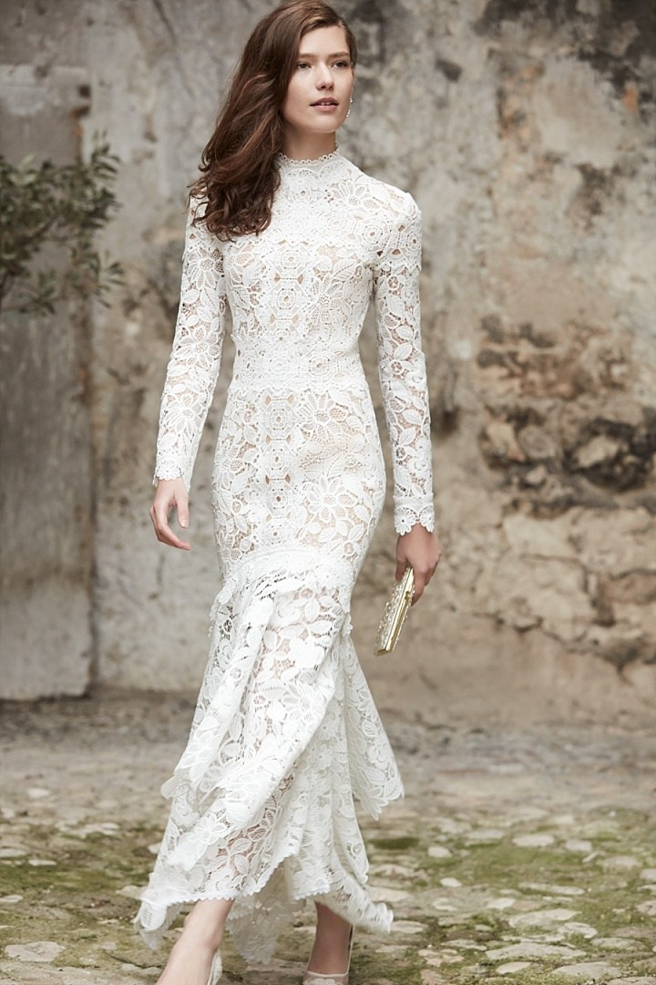 Nessa gown of floral guipure, the long sleeves and high neck may be demure, but the high low hem exudes a touch of sass