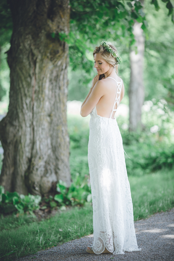 The bride was rocking an ivory lace dress with spaghetti straps and an eye catching back to hint on a modern feel
