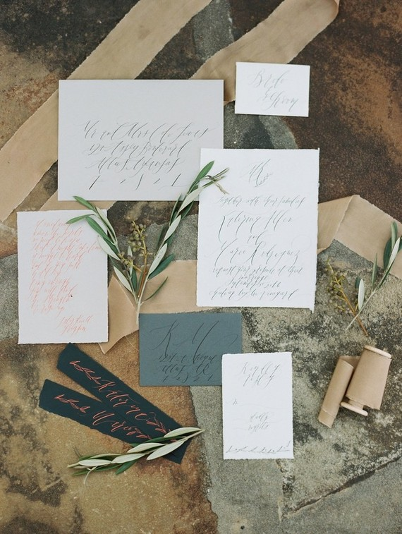 The stationery is simple and textural with calligraphy