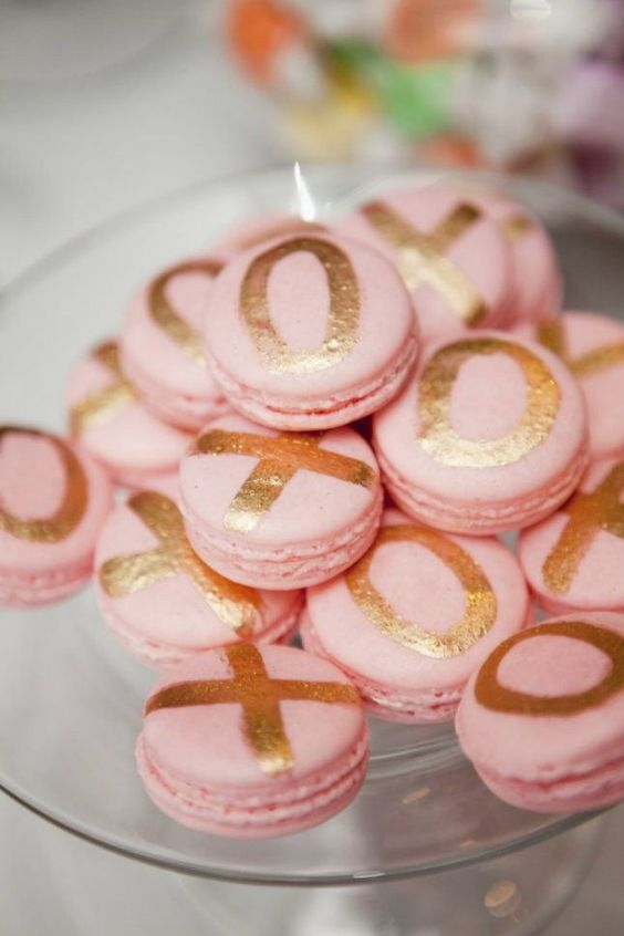 pink macarons with gilded XO letters