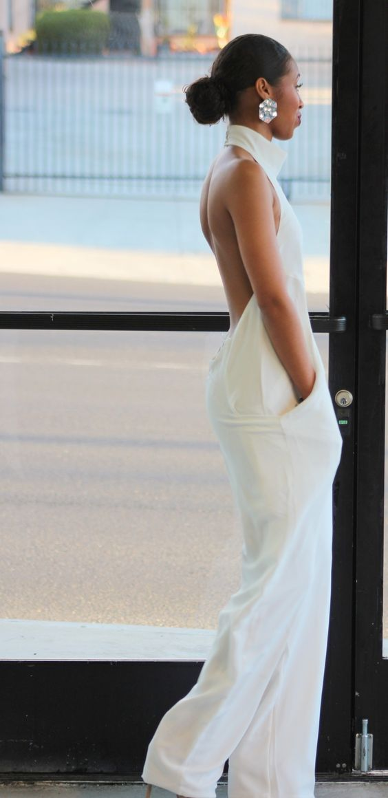 white backless halter neckline pantsuit with pockets