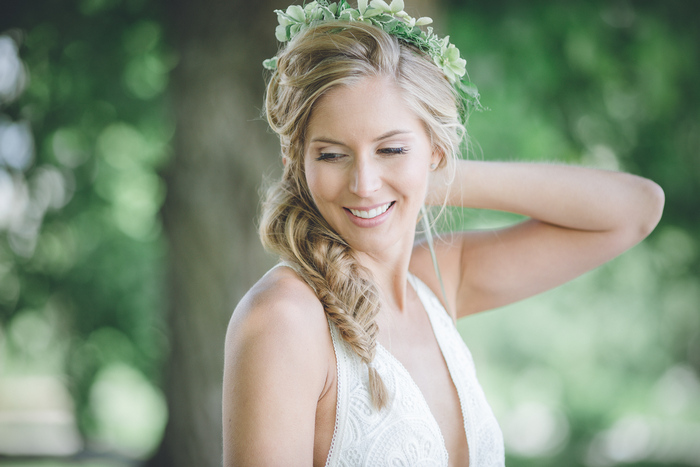 Her succulent and foliage headpiece and a braided hairstyle are a perfect fit for the relaxed rustic dress