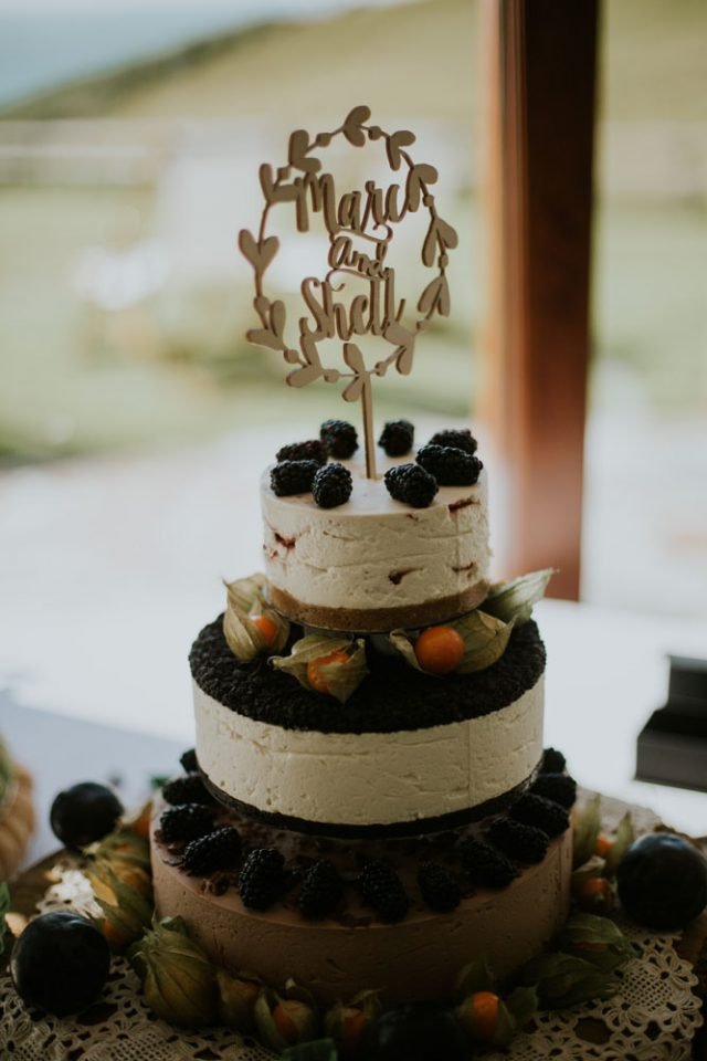 One of the wedding cakes was a cheesecake topepd with fruit and berries