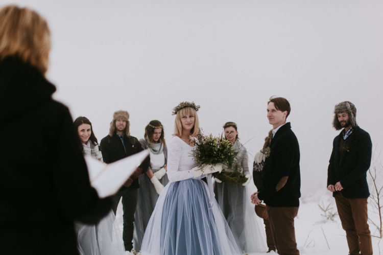 The bride chose a bridal separate with a long-sleeved white lace top and a grey layered tulle skirt