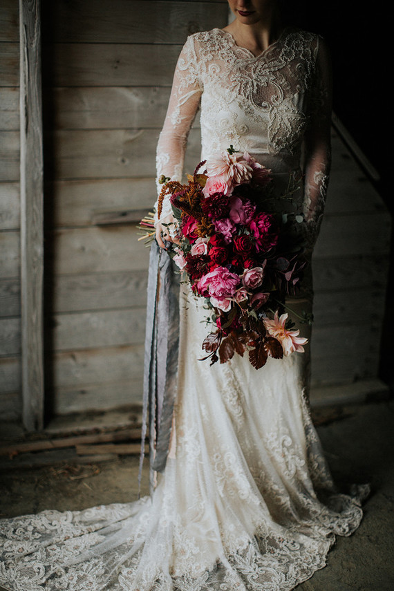 The bride was wearing a gorgeous lace applique Claire Pettibone gown with long sleeves and an illusion neckline