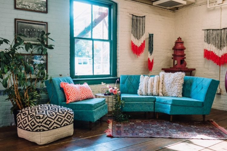 The lounge is industrial, with lots of bold colors and some yarn decor