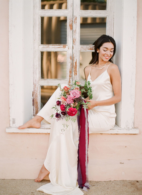 The second bridal look was done with a simple spaghetti strap maxi dress and modern jewelry, simple loose hair