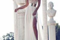 04 deep V-neckline wedding gown with a side slit and a metallic belt