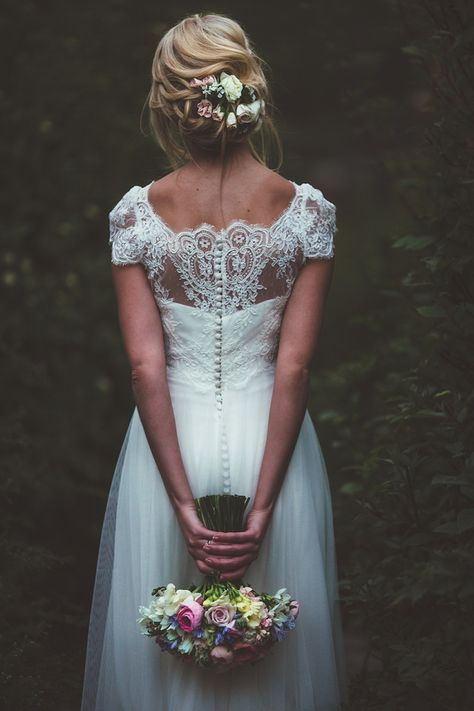 lace illusion back, cap sleeves and buttons look amazing and very feminine
