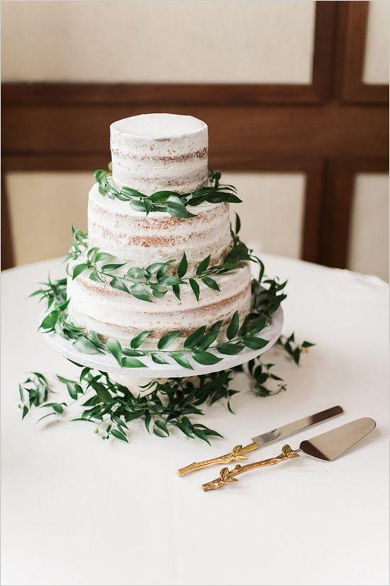 spring-inspired semi naked wedding cake with fresh greenery