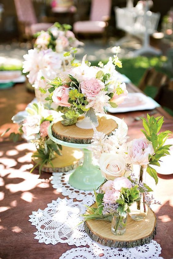 table centerpieces with various florals and greenery