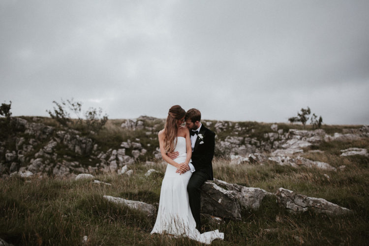 the groom opted for a black tux and the bride chose an elegant mermaid dress without straps