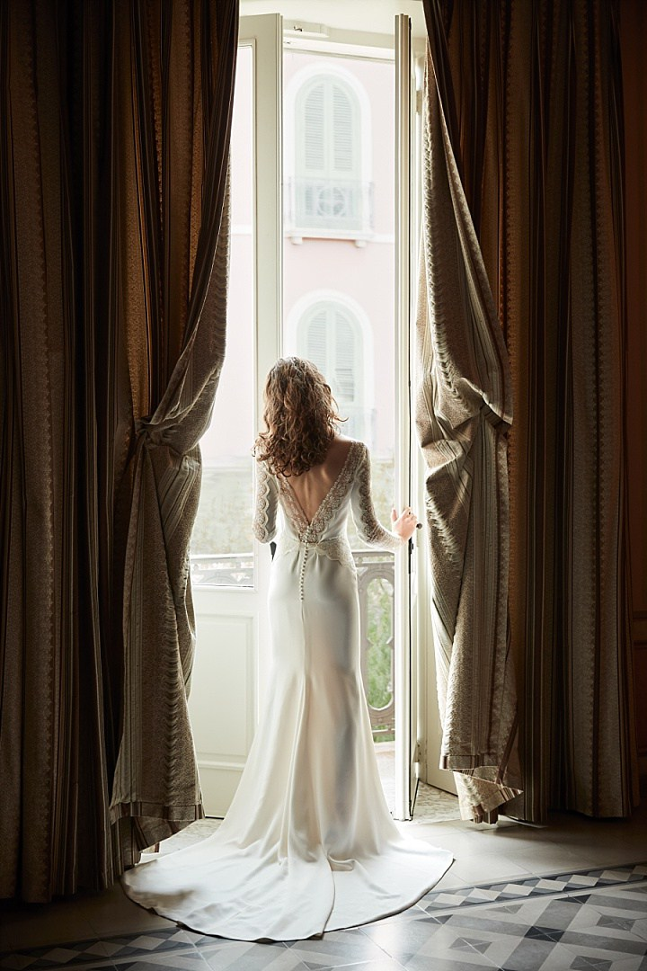 Sol romantic crepe gown cuts a graceful silhouette with graphic lace sleeves and draped skirt, the bateau neckline creates a demure profile