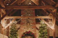 05 The barn was decorated with a lot of lights, evergreens and candles, and it looked Christmassy