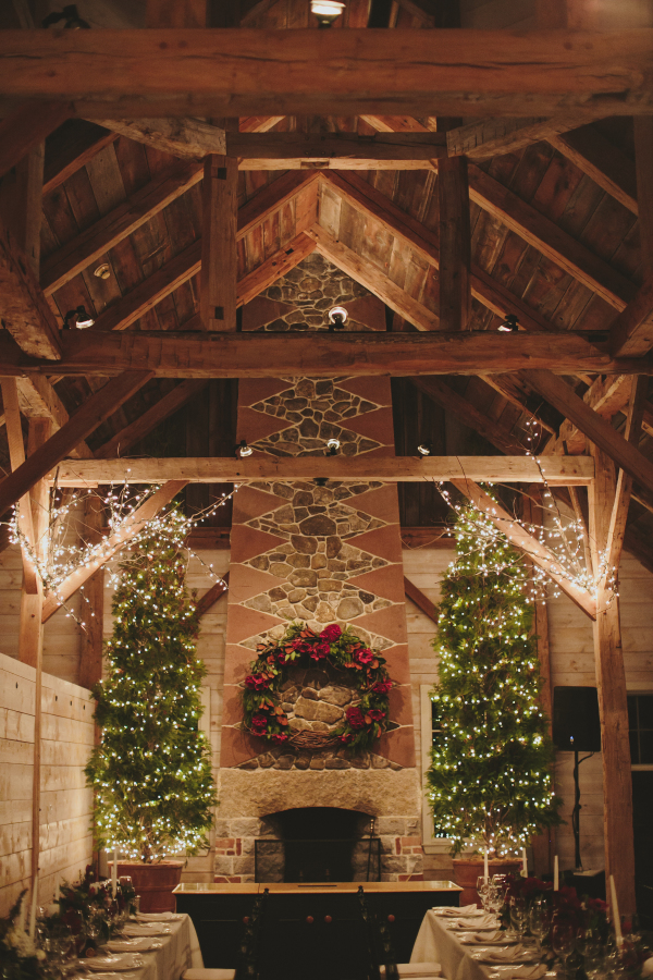 The barn was decorated with a lot of lights, evergreens and candles, and it looked Christmassy
