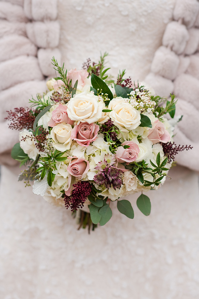The bouquet was romantic, wwith burgundy and blush tones