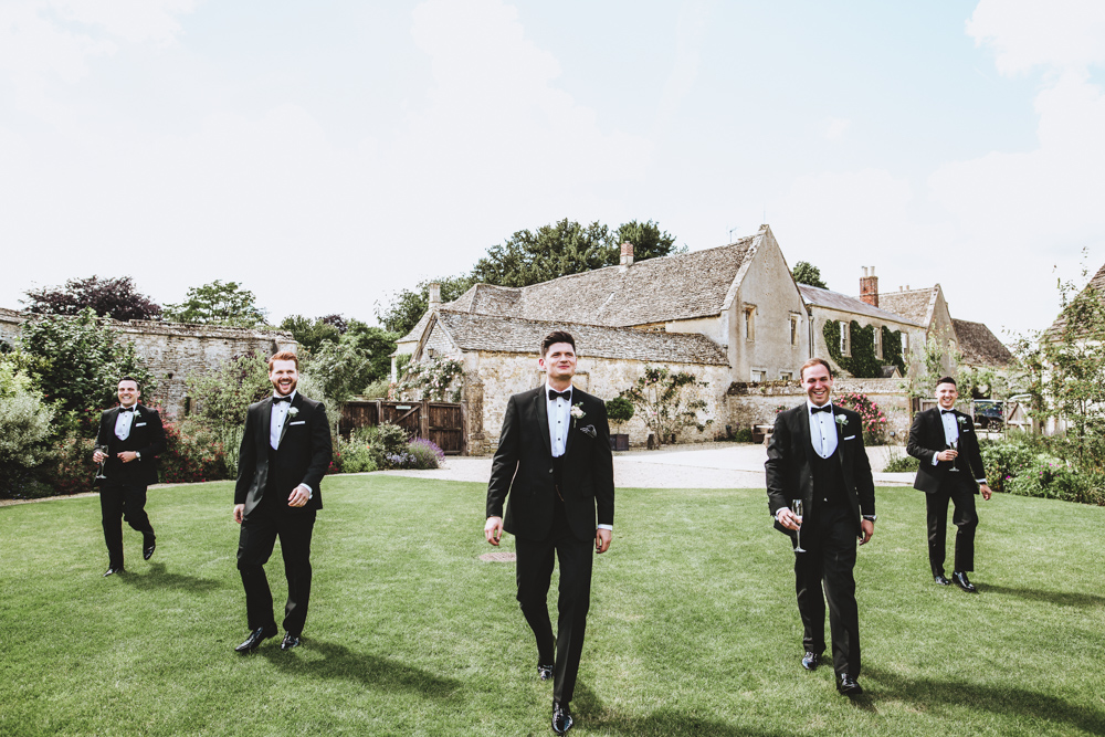 The groom and groomsmen went conservative with classical black tuxedos and bow ties