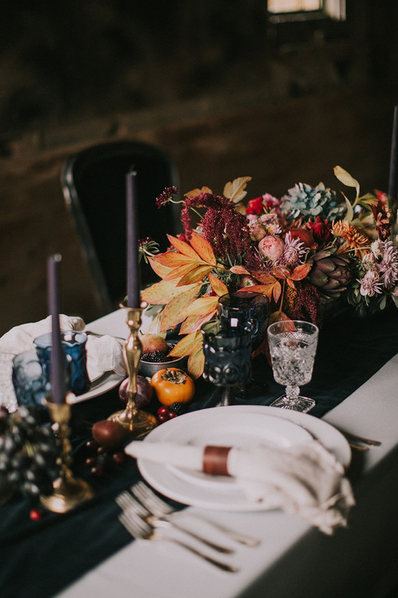 The tablescape was a moody one, in traditional fall colors with fall leaves and fruit, looked very decadent
