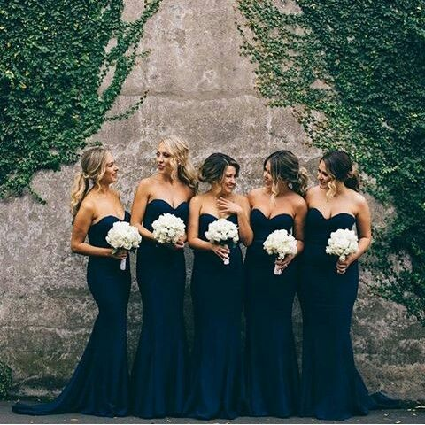 elegant strapless navy bridesmaids' dresses and white bouquets