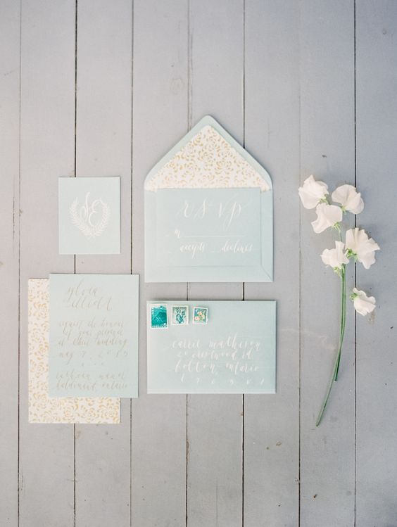 light blue and gold invitations for a pastel affair