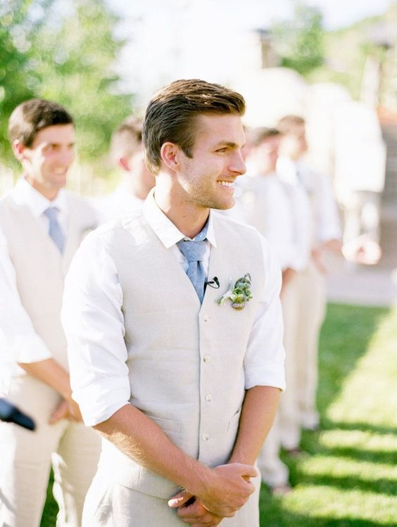 neutral no-jacket groom's look with a blue tie