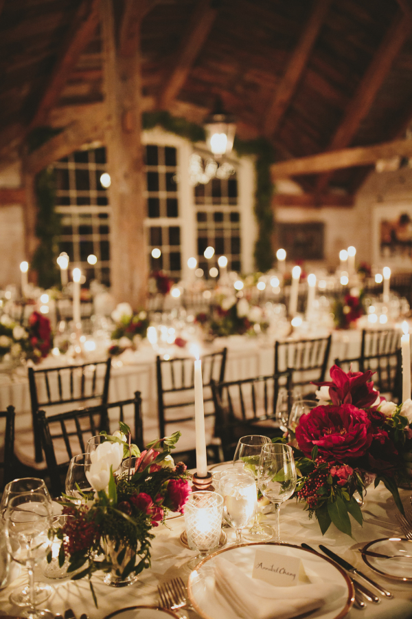The table decor was simple and elegant, with candles and red florals