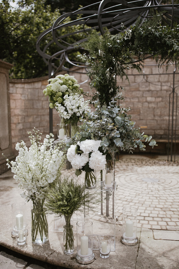 White mono-floral arrangements and candle lanterns are a perfect choice for an elegant soiree