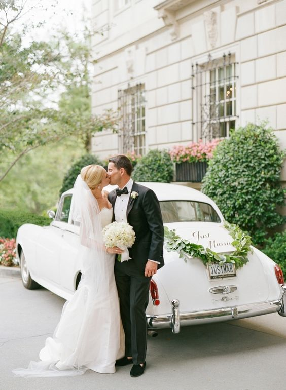 a black tuxedo and a strapless ivory gown is a timeless idea for a couple