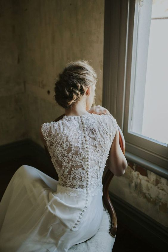 adorable wedding dress with a lace back and fabric-covered buttons and no sleeves