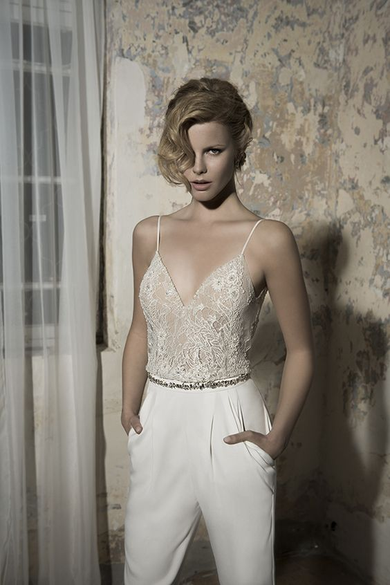 an ivory jumpsuit with a lace bodice and spaghetti straps and plain pants