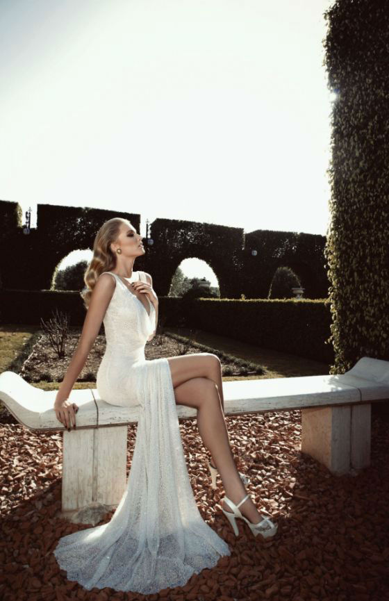 ethereal V-neckline wedding dress with beading and a side slit