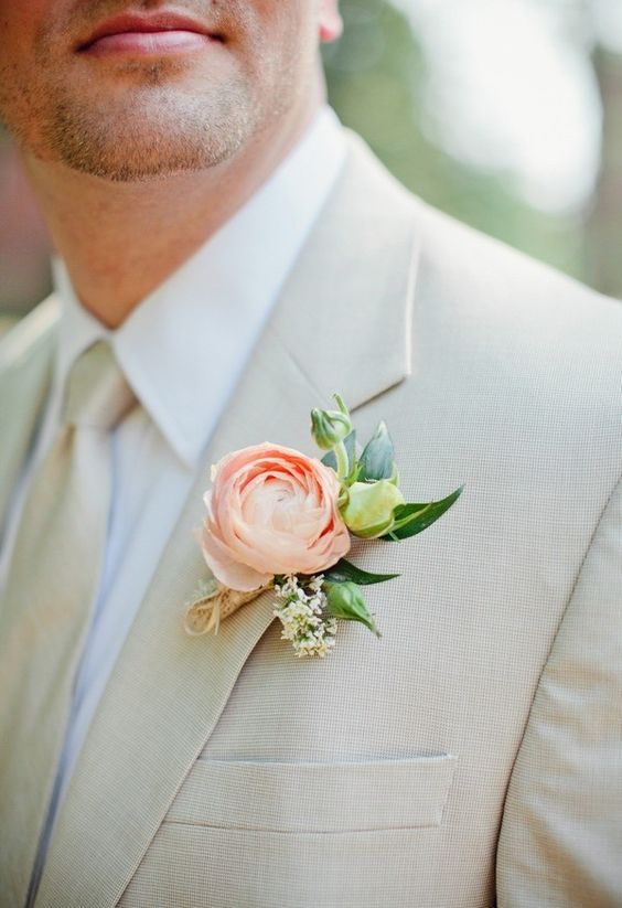 neutral groom's look with a peach-colored boutonniere