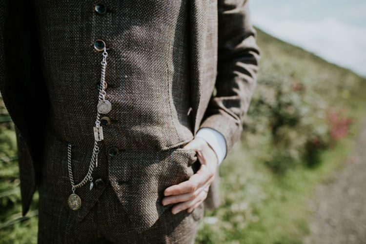 The groom was rocking a tweed suit and some vintage accessories