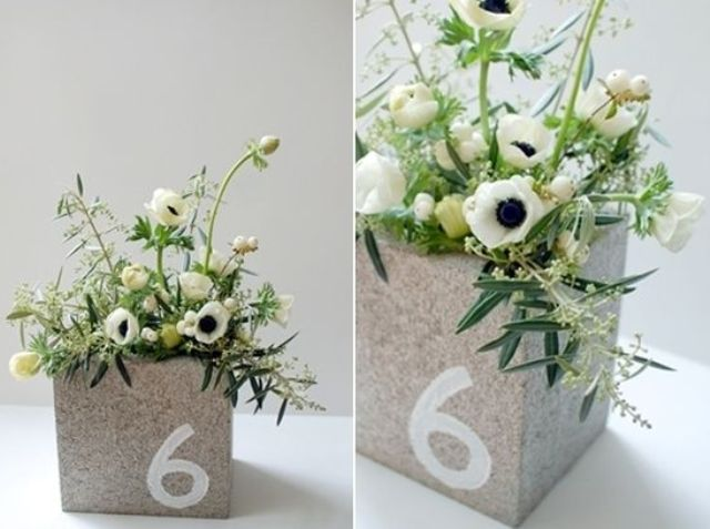 concrete box with neutral florals and a table number