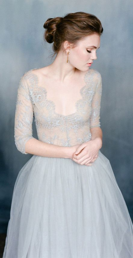 dove grey wedding dress with a lace bodice and a deep V neck and a plain skirt