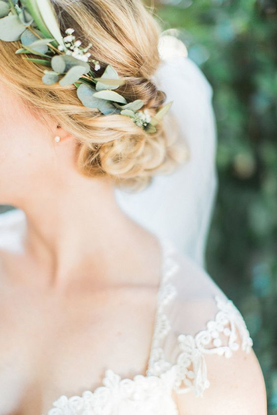 eucalyptus inserted into the braided updo