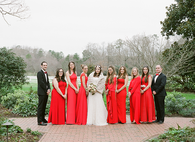 Red bridesmaids' dresses wwere the only shade from Christmas, all the rest was rustic, in beige and green